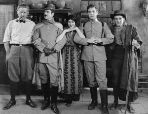 Photograph taken on the set of Thy Name is Woman (1924). Pictured with Barbara are (left to right) director Fred Niblo and co-stars Wallace MacDonald, Ramon Novarro, and William V. Mong.