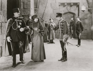 Barbara as Antoinette De Mauban in The Prisoner of Zenda; pictured with Stuart Holmes (as Black Michael, on far L) and Ramon Novarro (as Rupert of Hentzau, on R in foreground). As a component of one of the film's subplots, Antoinette ultimately betrays her traitorous lover (Black Michael) and enables the rescue of the king---all the while evading Rupert's impassioned advances.