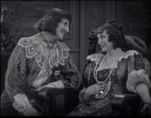 Barbara as Milady de Winter in The Three Musketeers, preparing to steal the queen's jeweled buckle from the unsuspecting Duke of Buckingham (Thomas Holding) before D'Artagnan can retrieve it.